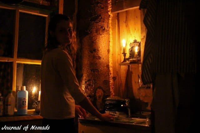 Doing the dishes by candle light