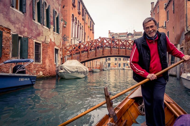 Hitchhiking a gondola in Venice -gondolier - Journal of Nomads