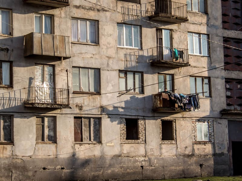Visiting ghosts of a distant past in Chiatura, the Cable Car City of Georgia - Journal of Nomads - soviet apartment buildings