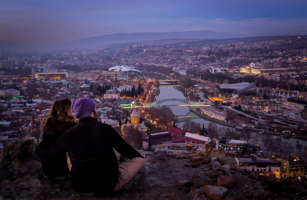 Backpacking in Georgia - everything you need to know - Journal of Nomads - sunset in Tbilisi