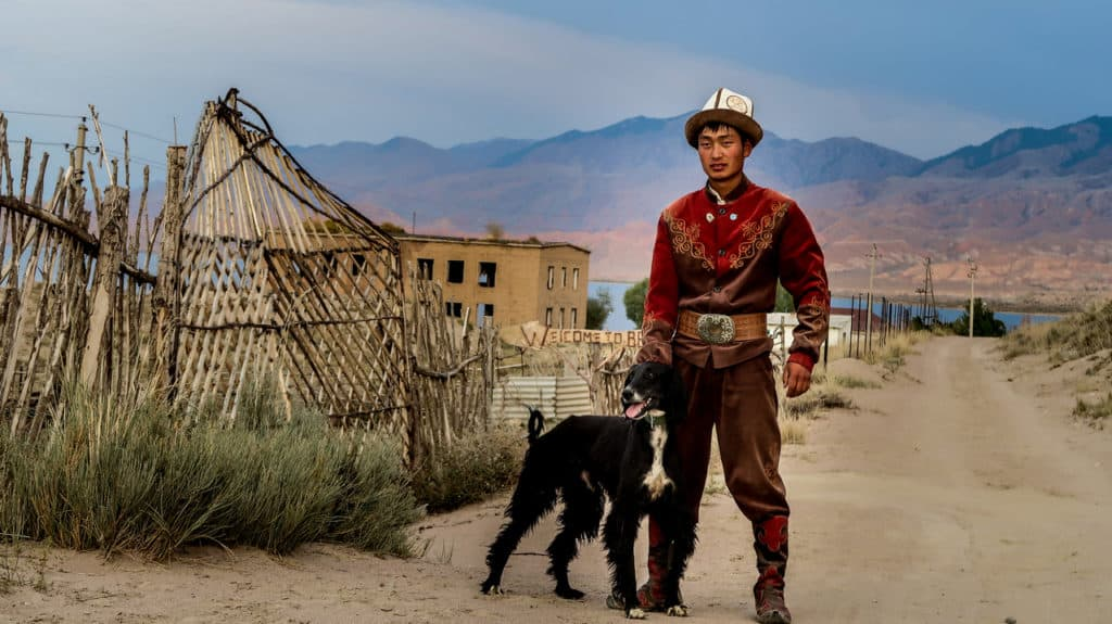 Eagle Hunters of Kyrgyzstan - Eagle Hunter with his hunting dog - Journal of Nomads