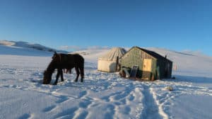 The Ultimate Travel guide for backpacking in Kyrgyzstan - Journal of Nomads - yurts in winter
