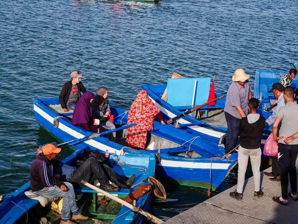 families enjoying boat ride - boat ride bou regreg river - journal of nomads