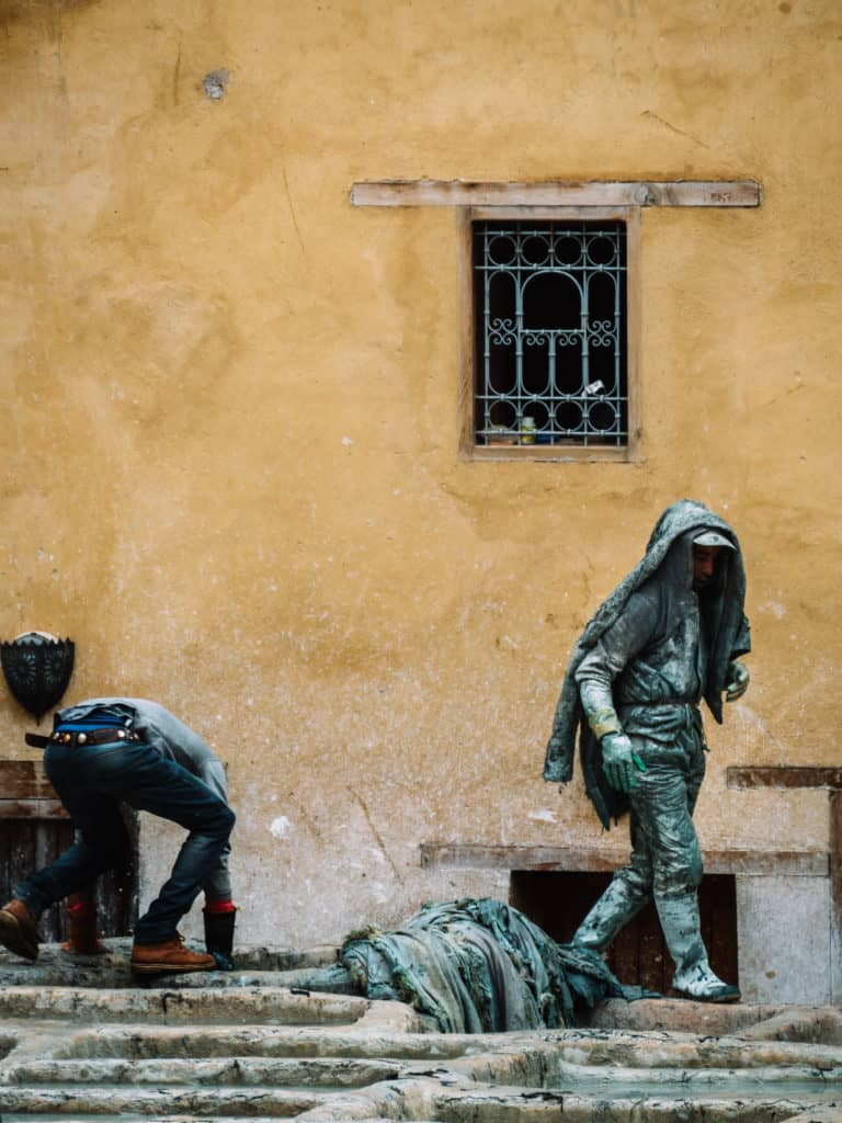 leather tanneries of Fez - tanning process - worker covered in pigeon poop - Journal of Nomads