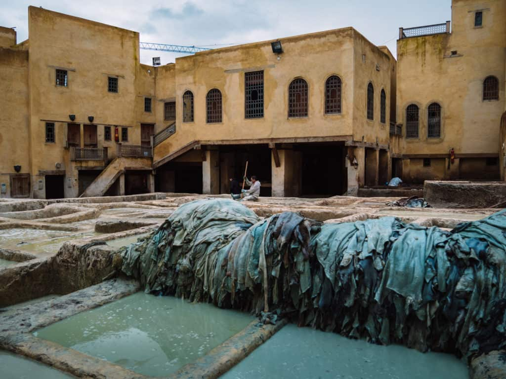 leather tanneries of Fez - tanning process -first step of tanning process -vats of pigeon poop and limestone - Journal of Nomads