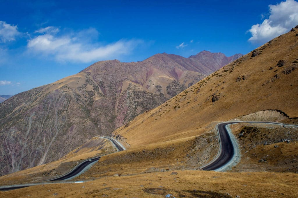 Getting around in Kyrgyzstan by public transport - windy mountain roads - Journal of Nomads