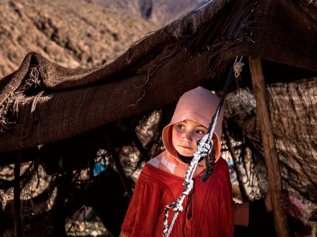 What you need to know about photographing people in Morocco - Berber child in Atlas Mountains in Morocco - Journal of Nomads