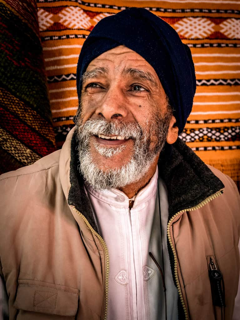 Portrait of carpet seller in Tangier Morocco - Journal of Nomads