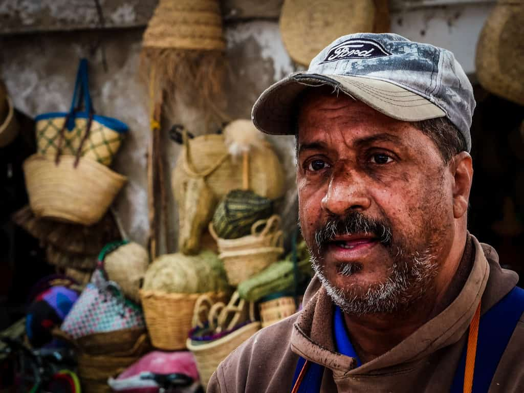 Close-up Moroccan man fishmarket Essaouira Morocco - Journal of Nomads