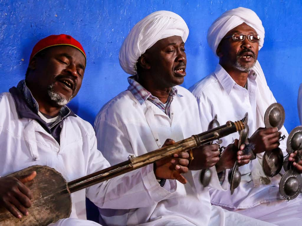 Gnawa players in Merzouga, Sahara desert, Morocco - Journal of Nomads