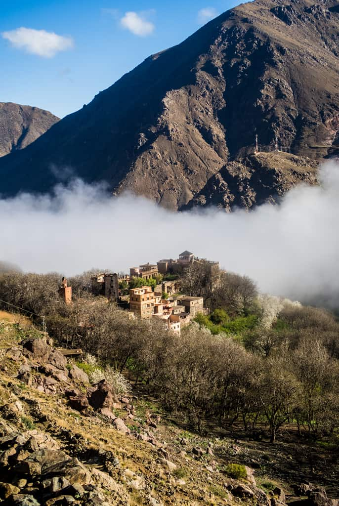 the view on imlil from armound - foggy mountains near imlil toubkal morocco - journal of nomads