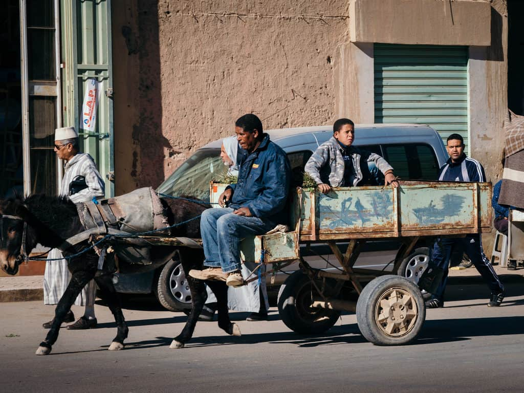 Street photography in Morocco - man with chariot - Journal of Nomads