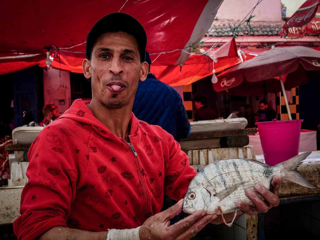 Man at fish market in Essouira Morocco - Journal of Nomads