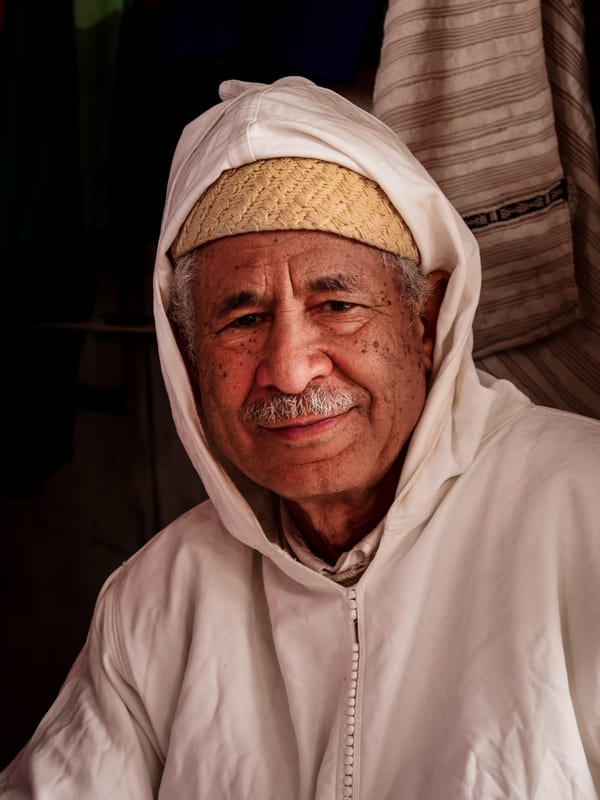Portrait Moroccan man in village near Merzouga Morocco - Journal of Nomads