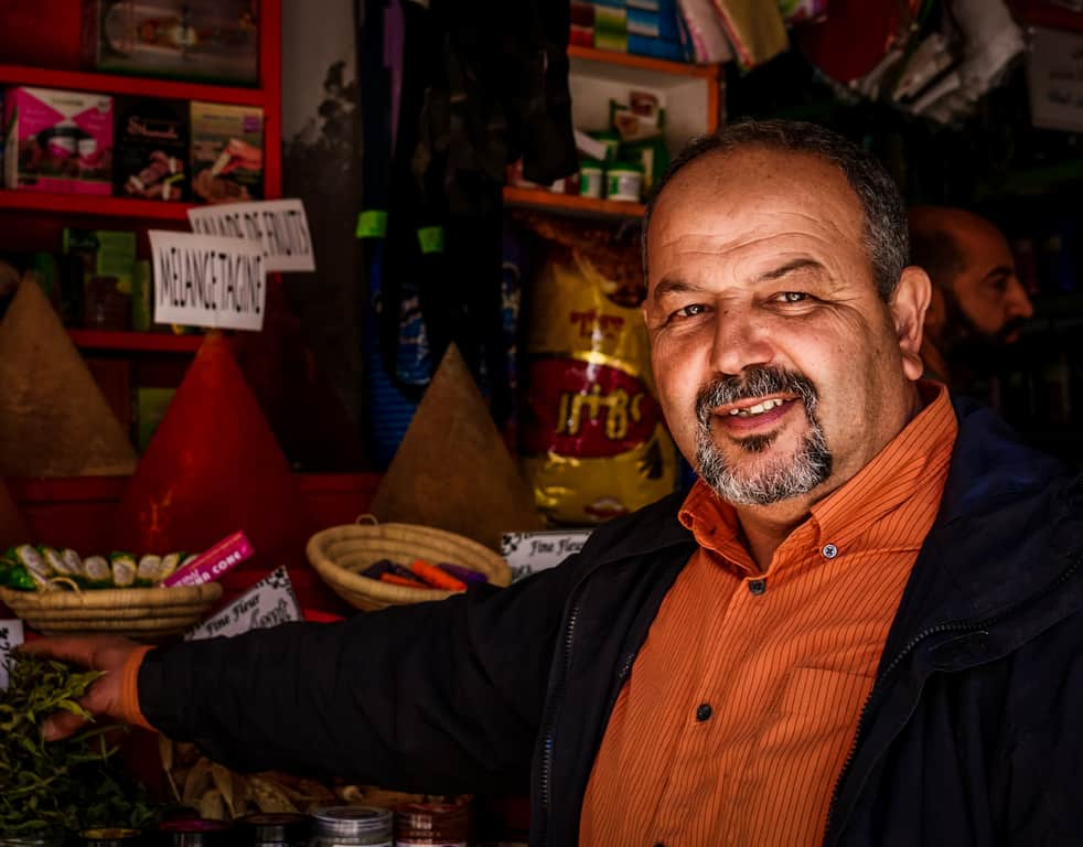 Photographing people in Morocco - man at market in Essaouira - Journal of Nomads