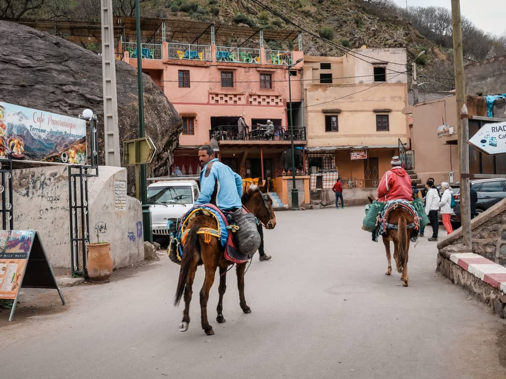 street of imlil morocco - man riding horse in imlil morocco - toubkal morocco - journal of nomads