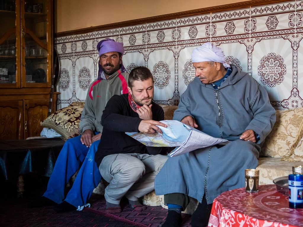 Studying map - talking with Moroccan people - hitchhiking in Morocco - Journal of Nomads