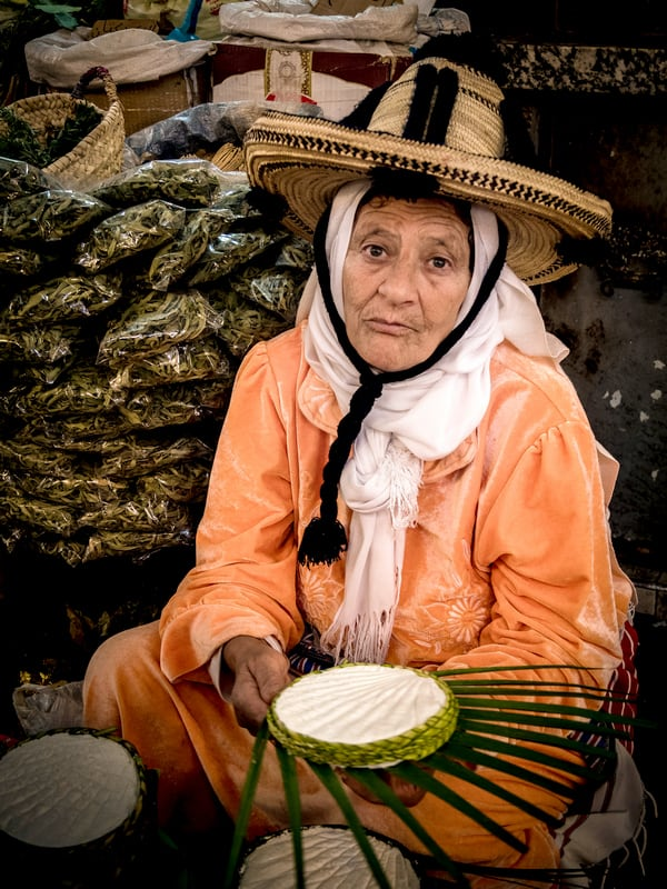 Moroccan woman selling cheese on a market in Tangier - Journal of Nomads