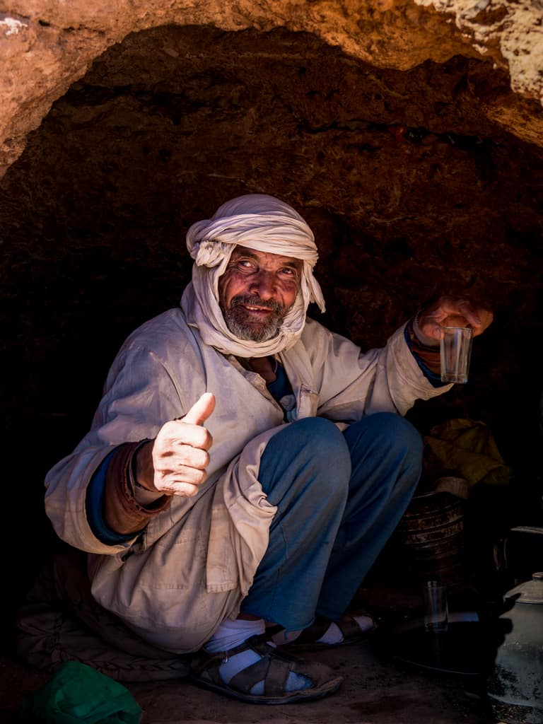 Berber man making tea in the Altas Mountains near Tinerhir Morocco - Journal of Nomads