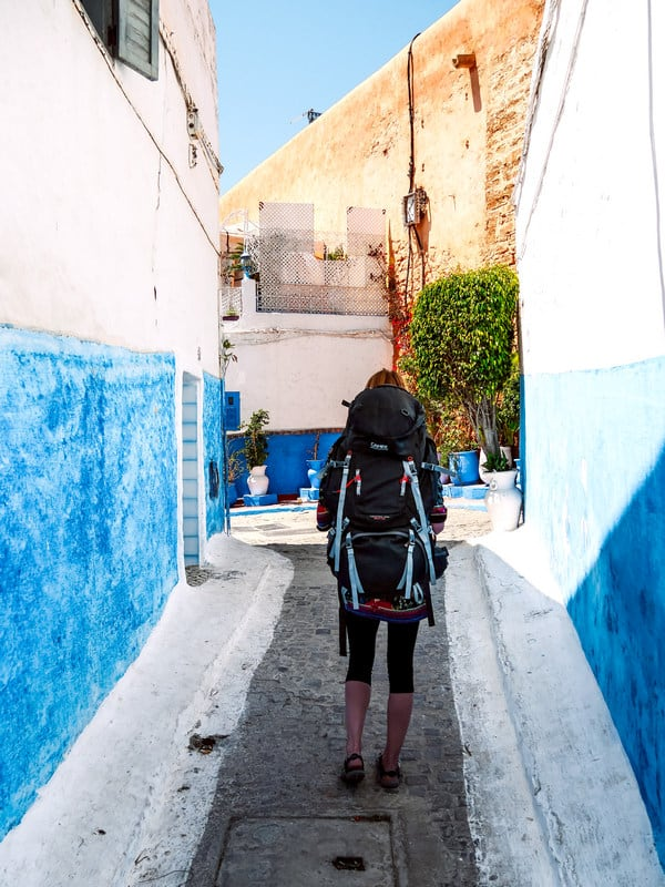 Why use a backpack instead of a suitcase for traveling - walking in small streets - Journal of Nomads