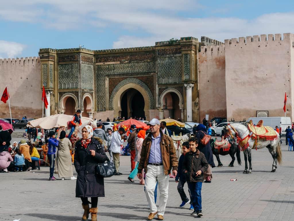 crowds Bab Mansour Meknes Morocco - journal of nomads