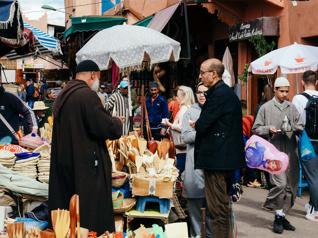 men in the market old city Marrakesh Morocco - journal of nomads