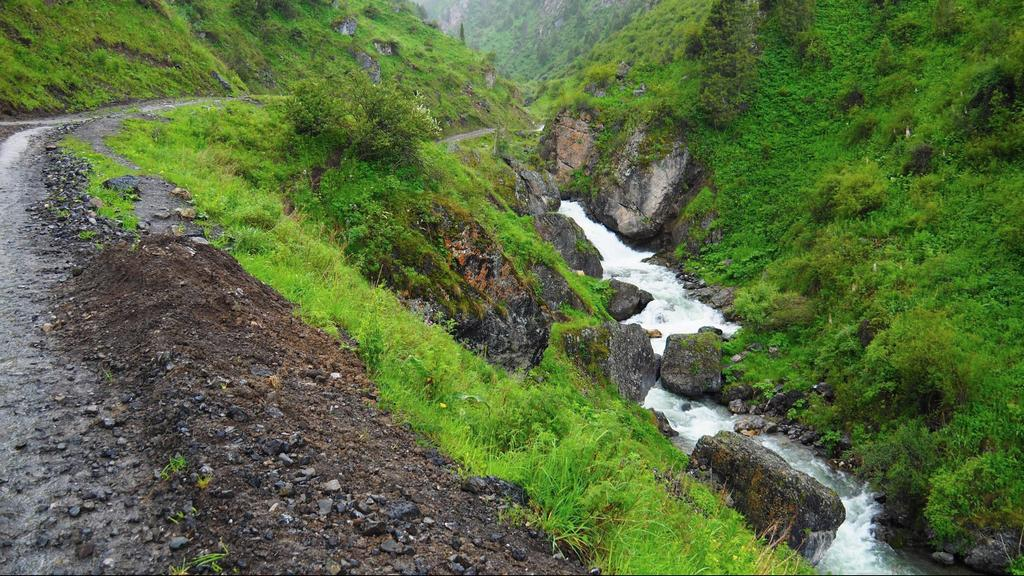 Trekking near Osh Kyrgyzstan - mountain road - rain in Kyrgyzstan - Journal of nomads